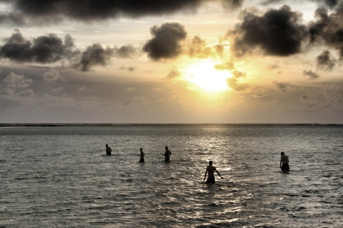 Swimmers at sunrise